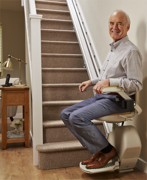 man-at-bottom-of-straight-stairlift